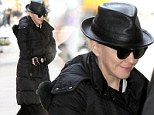 Madonna was swamped in layers of black, including a leather fedora and a heavy fur-lined puffer coat, in New York City on Saturday