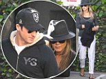 Feathering the nest! Jennifer Aniston plays mix and match in fedora and flip flops while antique shopping with Justin Theroux