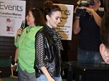 A lovely leading lady! Supportive star Lily Collins lends a helping hand to the author of upcoming novel-turned-movie