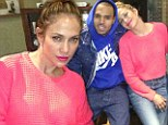 Making music together: Jennifer Lopez rests her head on Chris Brown's shoulder for studio Twitter picture