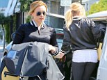 Varsity girl! Hilary Duff jazzes up her workout attire with a bomber jacket and shows off her slimmer size in tight leggings