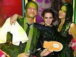 Good sport: Kristen Stewart didn't get slimed but she was happy to get covered in the sticky stuff with Neil Patrick Harris and Sandra Bullock