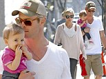 Chris Hemsworth and his wife Elsa Pataky make a quick run for a coffee and a bottle of water with their daughter India Rose Hemsworth in Venice Beach, California