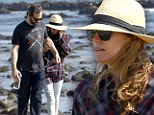 What's their secret? Leslie Mann and Judd Apatow look like two teenagers in love on beach stroll after 16 years of marriage