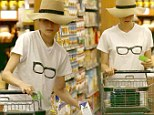 Dowdy Diane Kruger covers her make-up free face with a floppy hat grocery shopping at Gelson's