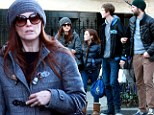 Julianne Moore warms up in chilly New York as she feasts on Italian food with her family