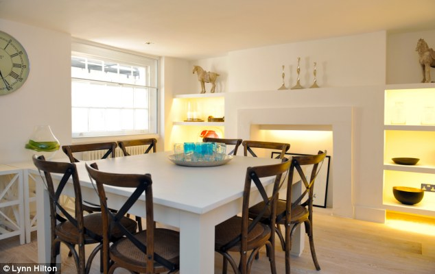 Welcoming light: The conversion took 13 months and saw the kitchen moved into the basement of the house