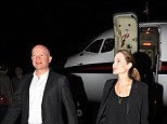 Unlikely pair: Foreign Secretary William Hague and Oscar-winning actress Angelina Jolie arrive in Rwanda where they are due to meet rape victims