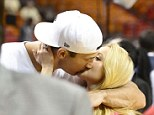 Kiss me! Hayden Panettiere and Wladimir Klitschko locked lips at the Miami Heat game in Florida on Sunday