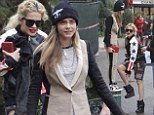 They even shop together: Rita Ora enjoys some retail therapy with 'Wifey' Cara Delevingne
