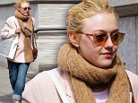Dakota Fanning matches her outfit to her new hair colour as she wears pink and tan shopping in New York