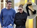 Modern Family Actress wears bizarre ensemble of gym kit, skyscraper heels and her boyfriend's big coat