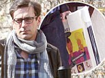 Beavis and Butt-Head do Mad Men! Jon Hamm spotted with picture of cult cartoon duo in Los Angeles