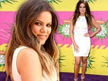 The white stuff! Khloe Kardashian is first on the carpet at the Kid's Choice Awards in a classy mini dress and matching heels