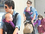 Maggie Gyllenhaal and her daughter wear matching animal print trousers at LAX