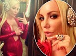 No-one's looking at your jewels! Crystal Hefner leaves very little to the imagination as she unzips her very revealing shiny and tight jumpsuit