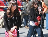 Too tight for comfort: Lea Michele hid behind her purse in jeans that were a little too snug