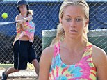 From Playboy to tomboy! Kendra Wilkinson takes a swing at softball game in tie-dye shirt and jersey shorts