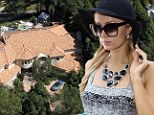 Paris Hilton becomes the latest 'swatting' victim after police are called to her Hollywood home over bogus break in