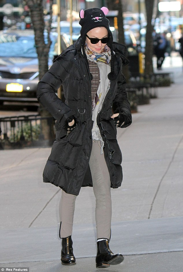 Cat in the hat: Madonna sported a feline-inspired cap during an outing in New York with her four children