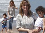 She's her little beach babe! Ellen Pompeo spends afternoon by the sea with her daughter Stella