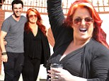 Ready to quickstep! Dancing with the Stars' Wynonna Judd beams on her way out of rehearsal alongside her partner