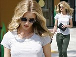 A morning perk up! Rosie Huntington-Whiteley bounds out of breakfast cafe with bouncy beautiful hair