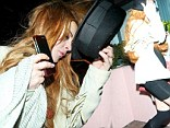 Exclusive pictures: Lindsay Lohan leaves private club looking disheveled after a night of partying