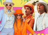 Kids' Choice Awards 2013: Ke$ha and her brother suit up Dumb & Dumber style on the purple carpet