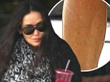 A hairy situation: Demi Moore reveals some fuzzy legs as she flashes her famous pins in a pair of mini shorts
