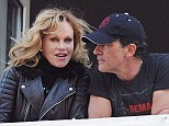 She supports his faith: Melanie Griffith joined husband Antonio Banderas to watch the Easter procession on their balcony in Malaga