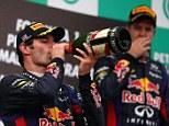 Dangerous: Mark Webber (left) swerved in front of Sebastien Vettel to show his anger