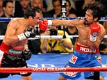 Hungry: Manny Pacquiao insists he will fight on, despite the manner of his last defeat