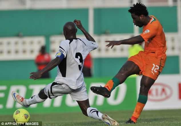 Strike rate: Bony (right), seen here in action for Ivory Coast, has scored 26 goals in 24 games this term