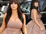 Does my bump look big in this?: Kim Kardashian stepped out in a voluminous dress for an interview on Good Morning America on Tuesday