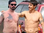 Come as you are! Dave Grohl and Anthony Kiedis have a battle of the band bodies in Hawaii