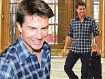 Hard to believe he's 50! Tom Cruise sports youthful style in checked shirt and shows off a wrinkle-free face as he arrives in Beunos Aires for film premiere