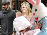 Spring forward: A.J. McLean and his wife Rochelle take their baby Ava Jaymes to meet the Easter Bunny