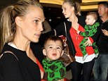 Need a helping hand? Make-up free Molly Sims juggles baby Brooks and big bag on family stroll through LAX