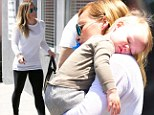 Just couldn't keep his eyes open! Hilary Duff hoists sleeping son after he nods off during shopping trip
