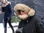 Well she is South African! Charlize Theron wraps up tight as she feels the cold filming TV show in Boston