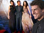 Cruise control: Tom is the ultimate leading man as leads his two beautiful co-stars down the red carpet at Oblivion premiere