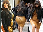 Still in Spanx! Kim Kardashian gives a glimpse of her girdle as she squeezes her pregnancy curves into a VERY tight leather shift dress