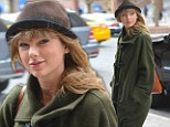 Trying to ward the boys off? Taylor Swift steps out in uncharacteristically frumpy duffel and hat combination