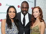 The ladies can't get enough of Idris: Mr Elba gets adorned with female attention at cocktail launch party