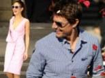 Flower power! Tom Cruise is showered in rose petals as Oblivion co-star Olga Kurylenko is stunning in pink in Argentina