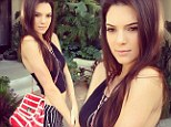 Model measurements: Kendall Jenner displays her tiny waist as she parades a cropped top from her own clothing line