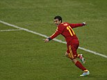 One up: Pedro wheels away in celebration after putting Spain in the lead