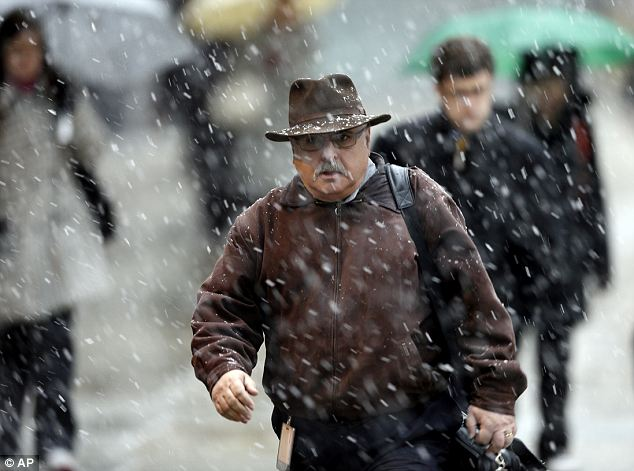Tired of winter: Commuters battle through the spring snowstorm in Philadelphia