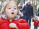 Becks and his little lady in red: David and daughter Harper co-ordinate in quilted jackets and matching trainers